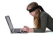 blind folded laptop user
